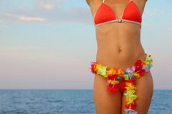 Woman dressed in bathing suit stands on beach Stock Photo