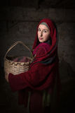 Woman dressed in biblical clothing. Portrait of a model in biblical clothing during a bible scene acting as Mary Magdalene or the virgin Mary royalty free stock photography