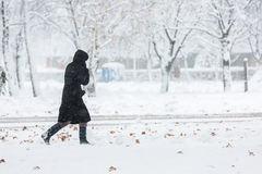Woman dressed in black coat walking alone Royalty Free Stock Photography