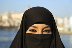 Woman dressed with black headscarf, chador on istanbul street, turkey Stock Photo