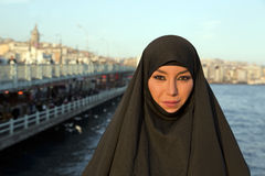 Woman dressed with black headscarf, chador on istanbul street, turkey Royalty Free Stock Images