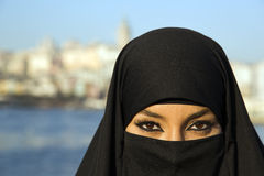 Woman dressed with black headscarf, chador on istanbul street, turkey Royalty Free Stock Photography
