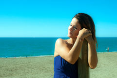Woman dressed in blue on the beach Royalty Free Stock Photo