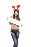 Woman dressed in blue jeans and reindeer horns, ho Stock Image