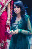 Woman dressed in a blue traditional indian dress for a wedding i Royalty Free Stock Photo