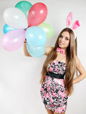 Bunny ears holds balloons Stock Photos