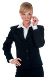 Woman dressed in a business suit in the studio Royalty Free Stock Images