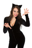 Woman dressed in catsuit. Playful woman dressed in catsuit and showing her teeth. Isolated on white Stock Images