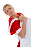Woman dressed for Christmas Stock Photos