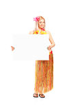 Woman dressed in a costume holding a panel Royalty Free Stock Photos