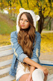 Woman dressed in cute hat with ears. Royalty Free Stock Image