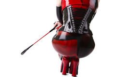 Woman dressed in dominatrix clothes. From back Royalty Free Stock Image
