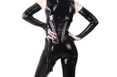 Woman dressed in dominatrix clothes. From back Royalty Free Stock Images
