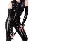 Woman dressed in dominatrix clothes stock image