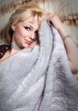 woman dressed in fur lying Royalty Free Stock Image