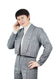 Woman Dressed In Gray Suit Talks By Phone Royalty Free Stock Photography