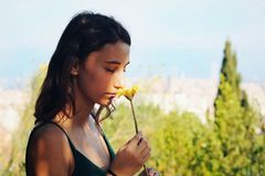 Woman smelling a yellow flower. stock photo