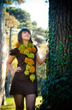 Woman dressed in handmade knitted dress and scarf. Stock Photos