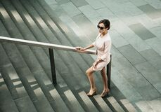 Woman Dressed In Business Style Next To The Stairs, Business And Career Concept Royalty Free Stock Photos