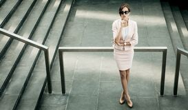 Woman Dressed In Business Style Next To The Stairs, Business And Career Concept Stock Photo