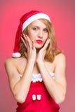 Woman dressed like Santa Claus Stock Photo