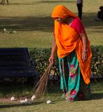 Woman Cleaning on the Grounds of the Amber Fort India royalty free stock image