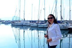 Woman dressed in nautical style in yacht marina stock image