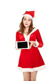 Woman dressed red costume holing tablet pc Stock Images