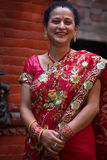 Woman dressed in a red traditional indian dress for a wedding in Stock Photos