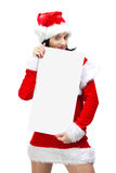 Woman dressed in santa claus with blank board Royalty Free Stock Image