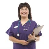 Woman dressed in scrubs. Middle-aged Filipino woman dressed in scrubs with stethoscope and clipboard stock photo