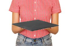 Woman dressed in shirt holding a square slate platter or a board in front of her. perspective view Template for your design. isola royalty free stock photos