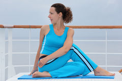 Woman dressed sits on cruise liner deck Royalty Free Stock Photo