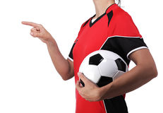 Woman dressed in soccer finger pointing at something. Photography of a bust of a woman dressed in soccer finger pointing at something Royalty Free Stock Photos