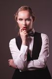 Woman dressed in suit and bow tie Royalty Free Stock Image