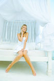 Woman dressed in a towel. Stock Images