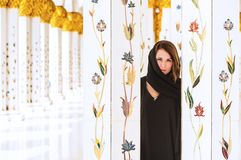 Woman dressed in traditional Arab. Mosque near columns Royalty Free Stock Photos