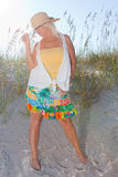 Woman Dressed Up On The Beach Royalty Free Stock Photo