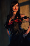Woman dressed up in black corset Royalty Free Stock Image