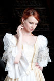 Woman dressed up like cinderella. Redhead young woman dressed up like cinderella at attic Stock Image