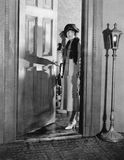 Woman dressed up standing in the doorway. (All persons depicted are no longer living and no estate exists. Supplier grants that there will be no model release Royalty Free Stock Photo