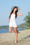 Woman dressed with white coveralls rompers joying the sunny day Royalty Free Stock Photography