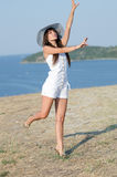 Woman dressed with white coveralls rompers joying the sunny day Royalty Free Stock Photos