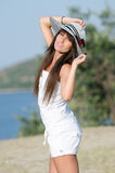 Woman dressed with white coveralls rompers joying the sunny day Stock Photo