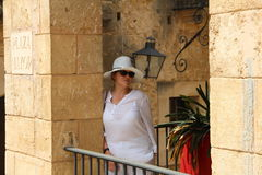 Woman in white at Pueblo Espanol Palma de Mallorca Spain. Woman dressed in white at Pueblo Espanol Palma de Mallorca Spain Royalty Free Stock Photos