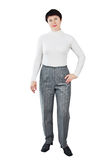 Woman Dressed In White Turtleneck And Grey Trousers Royalty Free Stock Image