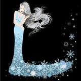 Woman dressed in winter snowflakes Royalty Free Stock Image