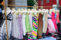 Woman dresses hanging on display at a flea market Stock Photography