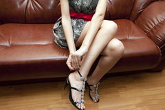 The woman dresses shoes Stock Images