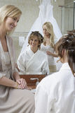 Woman Dressing Bride's Hair Stock Photography